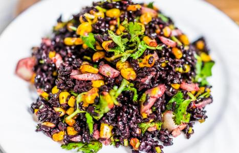 combination of black rice and brightly colored veggies makes this dish just pop on the plate